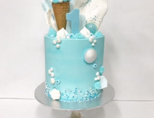 Baby blue buttercream first birthday cake